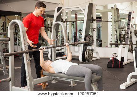 Athletic Woman Lifting A Barbell In A Gym