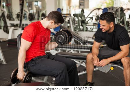 Personal Trainer Encouraging A Young Man