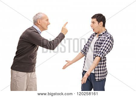 Studio shot of a senior father arguing with his adult son isolated on white background