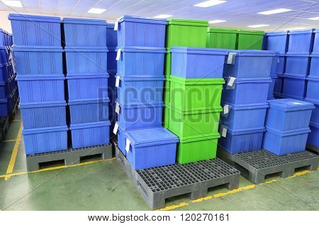 Blue Plastic Box Products In Industrial Factory Room.