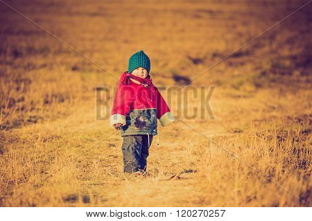 Vintage Photo Of Young Happy Boy Playing Outdoor