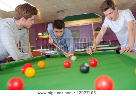 Young lads playing snooker