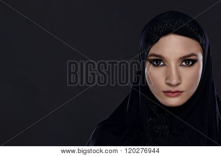 Close Portrait Of A Beautiful Muslim Woman Dressed In Black Hijab