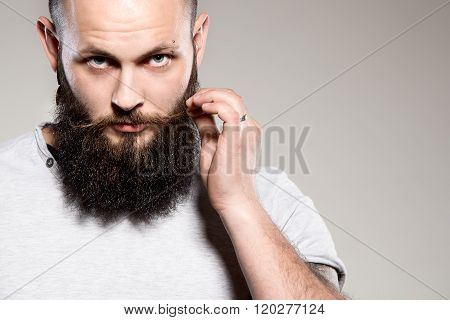 Bearded Man Touching Mustache