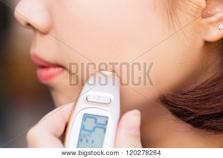 Close-up Of Person Hand Checking Skin Face With Dermatoscope.