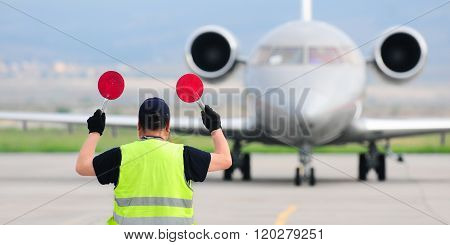 Air traffic controller holding signs