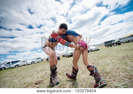 Darkhan, Mongolia - May 21, 2014:  Mongolia wresting during Naadam festival.