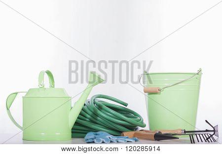 many gardening tools on white back ground