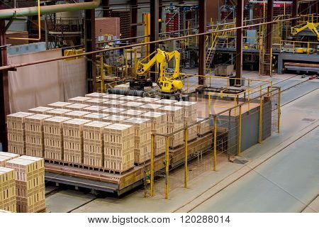 Manufactured bricks stacked on pallets in workshop