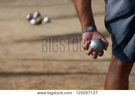 Senior men playing petanque