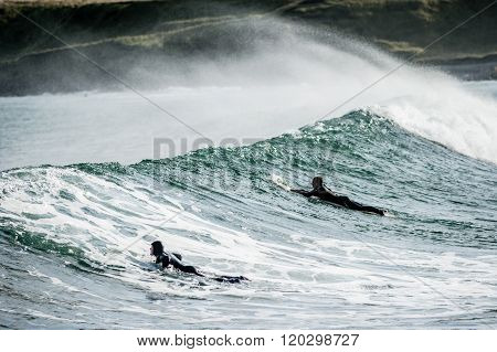 Surfers At Cullen in Scotland