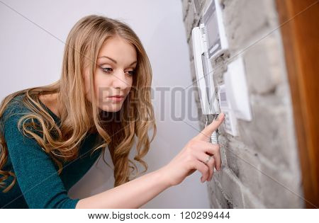 The Woman Entering Code Into The Keypad