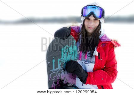 a girl with a snowboard