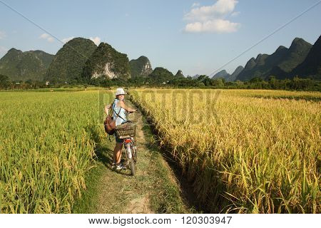 Girl Cycling in China country