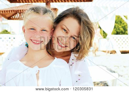 Luxury Resort Happy Family Relaxing . Mother And Daughter Lying Down On Deckchair Of Beach Resort .