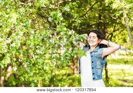 Attractive young woman enjoying her time outside in spring park