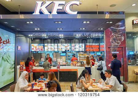 BANGKOK, THAILAND - JUNE 21, 2015: KFC restaurant interior. KFC is a fast food restaurant chain that specializes in fried chicken and is headquartered in Louisville, Kentucky, in the United States
