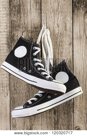 Black Sneakers On Wooden