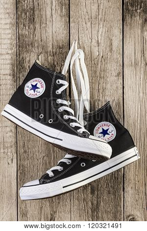Black Converse Shoes On Wooden