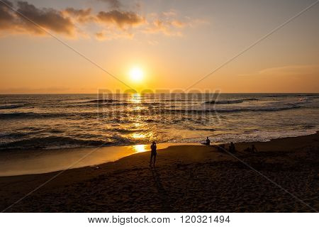 People watching a beautiful beach sunset stock picture