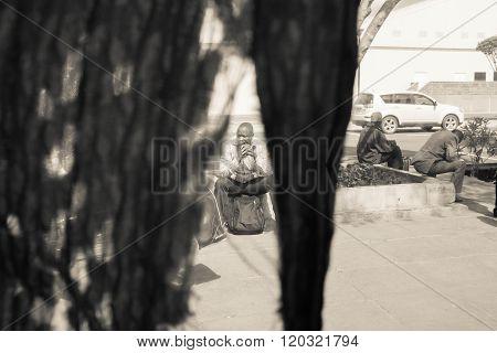 Nairobi, Kenya - January 14:  Three Unidentified  Men Wait On The Bus Station On January  14, 2016 I