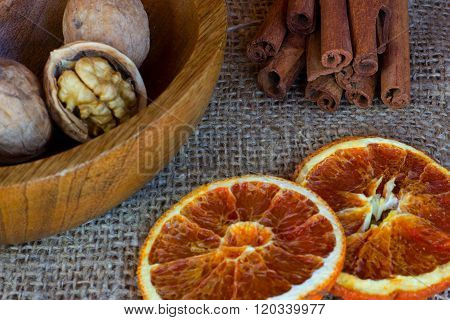 a plate of nuts, two of candied orange slice