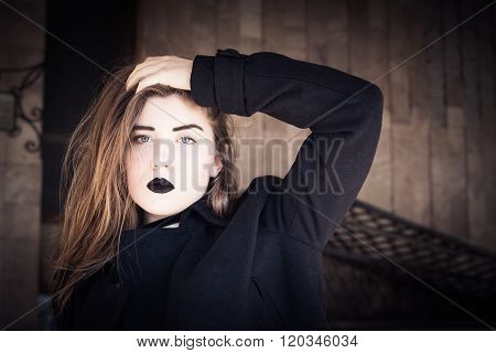 Portrait Of A Pretty Teenage Girl With Black Lipstick