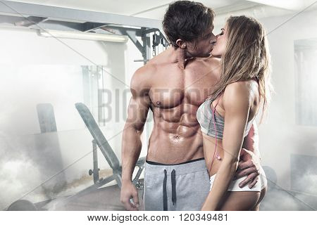 Beautiful Young Sporty Kissing Sexy Couple In Gym