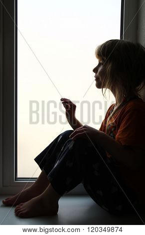 Child Looking Out The Window