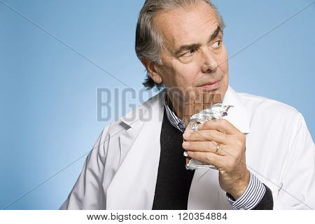 Doctor eating chocolate