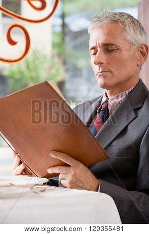 Man looking at a menu
