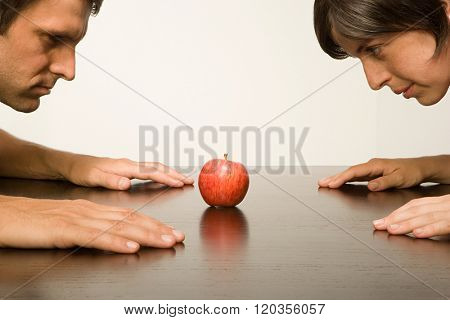 Couple staring at apple