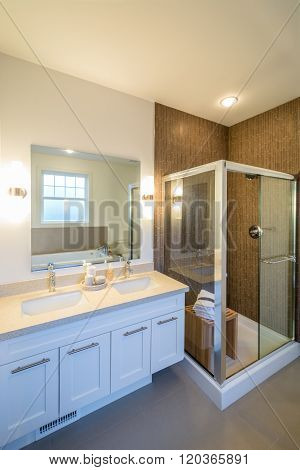 Luxury bright bathroom with a shower cabin. Interior design.