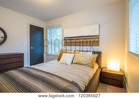 Modern bright bedroom interior design in a luxury house hotel.