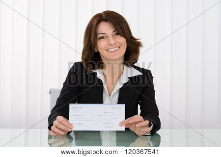Businesswoman Offering Cheque