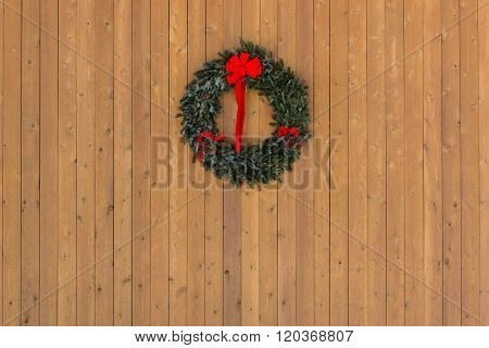 Christmas Wreath On Wooden Wall Horizontal