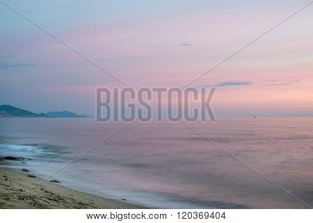 Mediterranean seascape at sunset with mountains on a background.