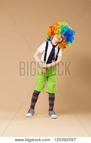 Little Boy In Clown Wig Dancing And Having Fun