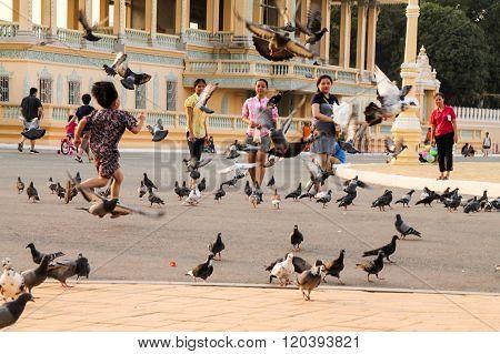 Cambodians Playing At The Royal Palace In Phnom Penh