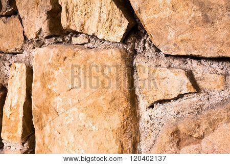 Large Glossy Stone Wall. Diagonal View.