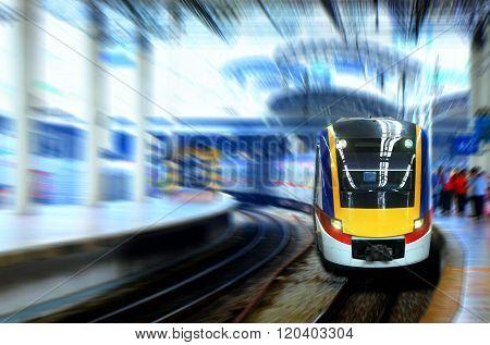 Fast Moving Train Leaving Station Platform