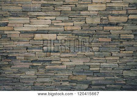 Ancient Wall Built Of Flat Stones