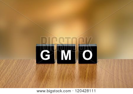 Gmo Or Genetically Modified Organism On Black Block