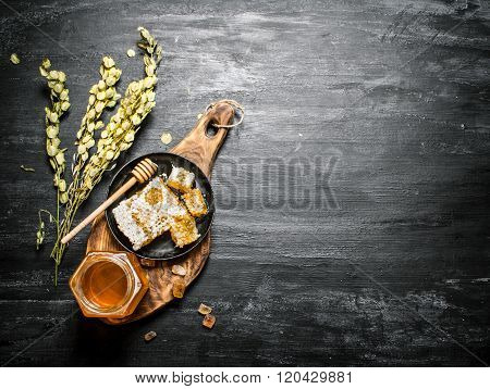 Honey Background. Natural Honey And Herbs On A Wooden Board.