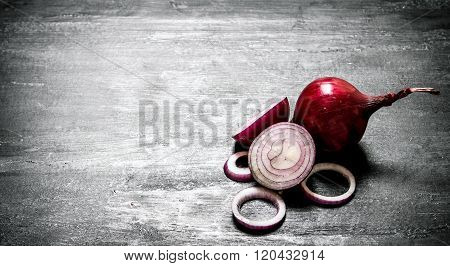 Fresh Red Onions. On Black Rustic Background.
