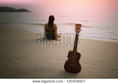 Beach, Sun, Sea And Sand woman with ukulele