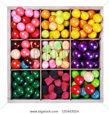Assortment Of Candy And Gum In A Wooden Box