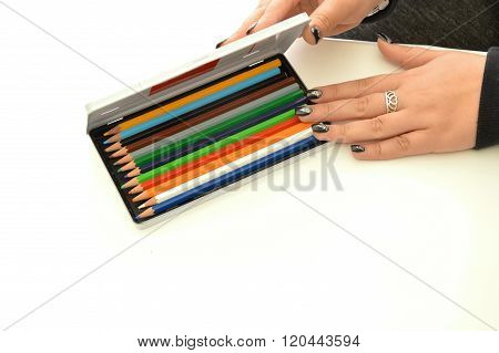 Colored pencils of a designer - The hands of an a designer and his colors