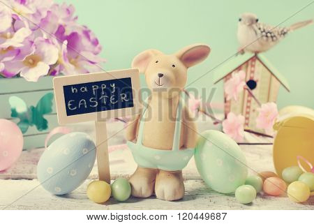 Vintage Style Easter Card With Clay Rabbit  And Decorations On Mint Background