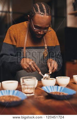 Professional African barista training to make perfect cup of cof